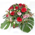 Red Roses & Eustomas in a basket